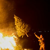Salem Fire Department Chief David Cody throws a Christmas tree on the bonfire during Salem's 14th annual Christmas tree bonfire at Dead Horse Beach. 1/6/17
