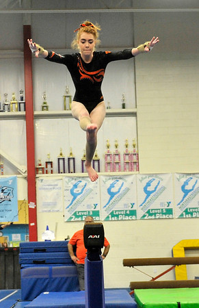 NICOLAS TANNER/Photo.   Hannah Marescalchi, a senior on the Beverly high school gymnastics team competes on the beam against  Gloucester high school at a meet held in the Sterling Center YMCA in Beverly. 1/19/17