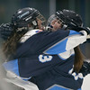 Peabody's Sammie Mirasolo and Cassie Mirasolo hug after their team scores in their game against Bishop Fenwick at the McVann-O'Keefe Skating Rink. 1/27/17