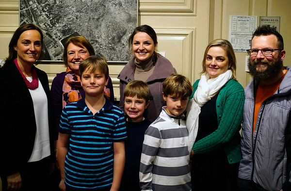 """NICOLAS TANNER/Photo.     From right to left, Cailin Kelleher DeBiase of Hamilton, Joanne Kelleher of Beverly, Mary Grace Kelleher of Beverly, Shannon Kelleher Perri of Groveland, Joe Kelleher of Beverly stand in front of Finn, Callum, and Harry DeBiase. At an exhibit called """"Chilly Business,"""" which focuses on a local ice production business opens at the Beverly Historical Society in Beverly. 1/19/17"""