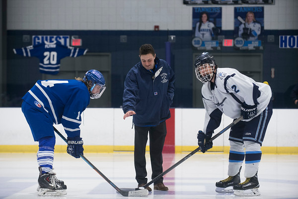 SAM GORESH/Staff photo. Matt Flynn, son of recently deceased ex-Peabody and Danvers head coach Kevin Flynn, drops the ceremonial first puck before Peabody play against Danvers at McVann-O'Keefe Rink. 1/10/17