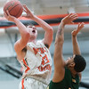 Beverly senior Patrick Gavin goes up for a basket as Lynn Classical junior Eric Solis attempts to stop him on defense in their game at Beverly High School. Lynn Classical won the game 68-65. 1/27/17