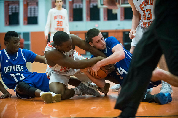 Beverly junior Hugh Calice fights Danvers senior Kieran Moriarty for the ball in their game at Beverly High School. 1/3/17