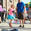 Kiera Smith, of Beverly, tosses a beanbag while playing corn hole with her father Brian, during the first Beverly Block Party on Saturday evening. DAVID LE/Staff photo. 7/12/14.