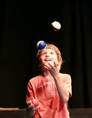 Artworks at Waring camper Thomas Kroa, 9, smiles while jugging during an end-of-camp Circus Major performance on Thursday afternoon. DAVID LE/Staff photo. 7/17/14.