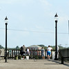 A bunch of fishermen gathered at the end of the pier next to the Beverly-Salem Bridge on a warm Monday afternoon. DAVID LE/Staff photo. 7/28/14.