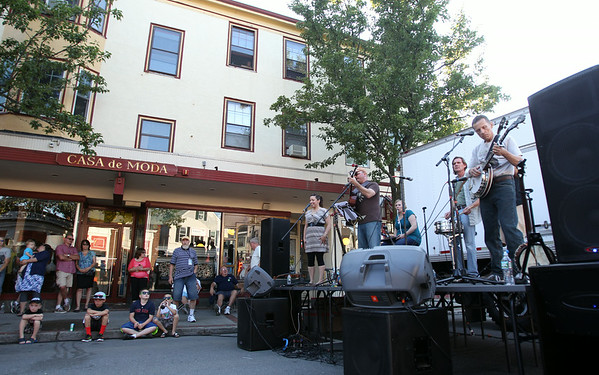 The Barn Burner's String Band plays on the stage set up in the middle of Cabot Street next to Casa de Moda during the first Beverly Block Party on Saturday evening. DAVID LE/Staff photo. 7/12/14.