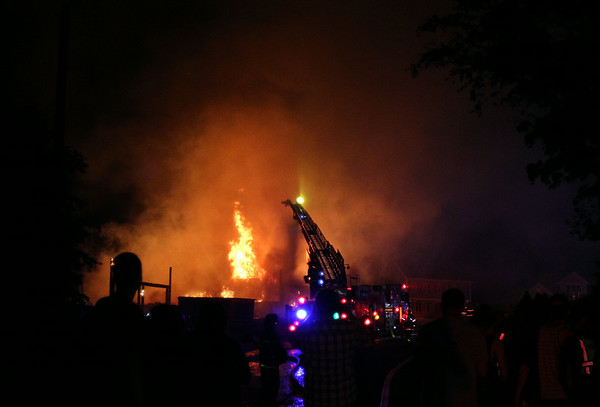 A raging fire broke out at 29 Folger Ave in Beverly late on Sunday evening. DAVID LE/Staff photo. 7/13/14.