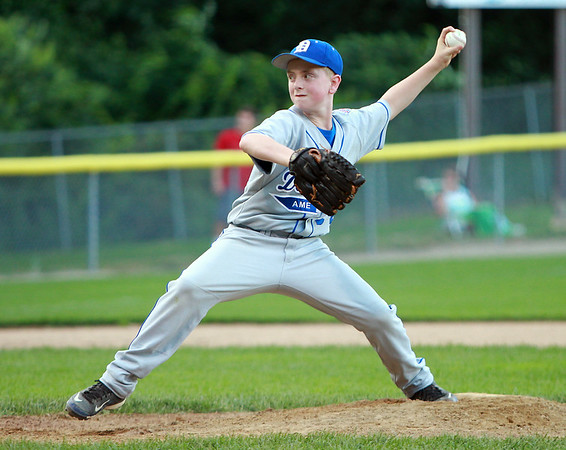 Danvers American starting pitcher Kevin Rooney fires a pitch against Beverly on Tuesday evening at Harry Ball Field in Beverly. DAVID LE/Staff photo. 7/8/14.