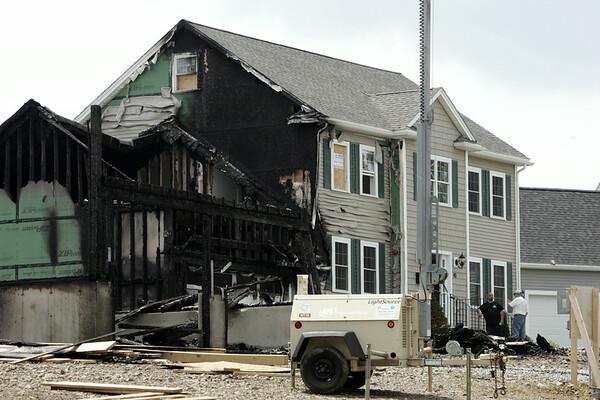 KEN YUSZKUS/Staff photo. The fire scene on Folger Avenue in Beverly.   7/14/14