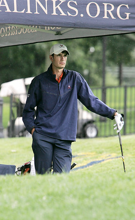 KEN YUSZKUS/Staff photo.   Nick McLaughlin waits for his turn under a tent  out of the rain at the 1st tee. This was the third day of play at 106th Mass. Amateur golf championship at Kernwood Country Club in Salem. 7/16/14