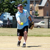 Peabody Mayor Ted Bettencourt throws a pitch during a charity softball game between Salem and Peabody City officials on Saturday morning. DAVID LE/Staff photo. 7/12/14.
