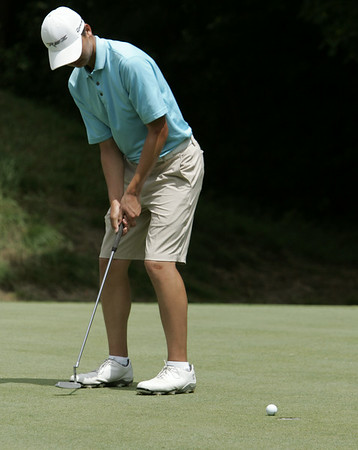 KEN YUSZKUS/Staff photo. Paul Lei of Middleton makes his putt on the 10th hole on the first day of play at the 105th Massachusetts Amateur Championship (golf) at Kernwood Country Club in Salem.   7/14/14