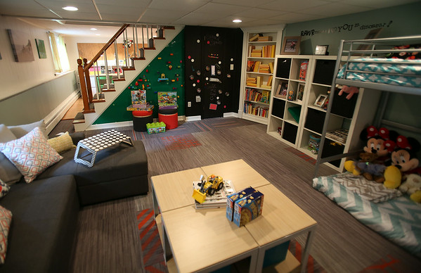 The renovated playroom in the Fessenden household. With the help of 75 volunteers, a nonprofit called Special Spaces Boston, did a three-day makeover of the downstairs playroom for Riley Fessenden and her brothers and sisters. DAVID LE/Staff photo. 7/26/14.