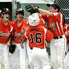 KEN YUSZKUS/Staff photo. Beverly's Shane Cassidy is welcomed back to the dugout by his teammates after hitting a homerun in the beginning of the Williamsport Little League District 15 tournament game against Hamilton-Wenham.  7/7/14