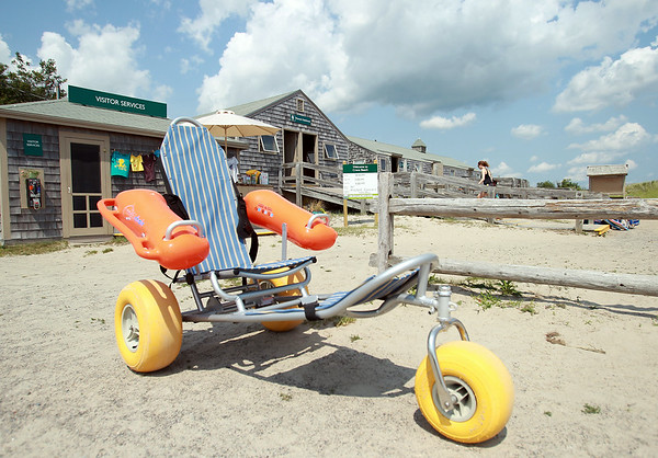 The Mobi-Chair, which was donated to the Reservation at Cranes Beach sits in front of the Visitor Services building. The chair was designed to allow the disabled get onto the beach and even float in the water. DAVID LE/Staff photo. 7/31/14.