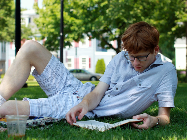 Matt Dinaro, of Amherst, sits in the shade on Beverly Common and reads a book on a hot Wednesday afternoon. DAVID LE/Staff photo. 7/23/14.