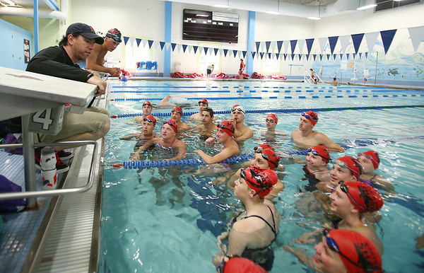 Chris Morgan is the new YNS Sharks Competitive Aquatics Director. Morgan instructs his swimmers on Friday afternoon. He and his team will be leaving on Saturday to go to Nationals. DAVID LE/Staff photo. 7/25/14.