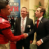 "Former Salem High School quarterback and current NFL Agent Sean Stellato, right, shakes hands with Genrri Rosario, one of the Salem High football captains for the fall, at a gala and book signing for Stellato's new book ""No Backing Down"" a book on the 1994 Salem High School Super Bowl football team. DAVID LE/Staff photo. 7/11/14."