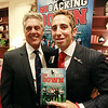 "NFL Agent and former Salem High School quarterback Sean Stellato with his old coach Ken Perrone at a gala and book signing for Stellato's new book ""No Backing Down"" a book on the 1994 Salem High School Super Bowl football team. DAVID LE/Staff photo. 7/11/14."