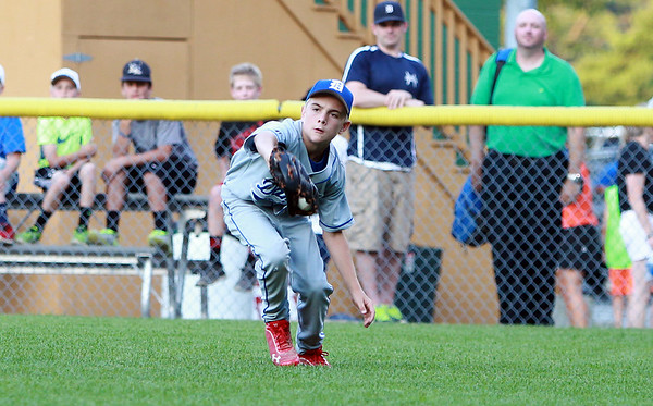 Danvers American right fielder Matt McCarthy snags a sinking line drive off a Beverly bat on Tuesday evening at Harry Ball Field in Beverly. DAVID LE/Staff photo. 7/8/14.