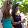 Emily Louras, left, and Samantha DiBella, of Peabody, look at jewelry at the first Salem Willows Seafood Festival on Saturday afternoon. DAVID LE/Staff photo. 7/12/14.