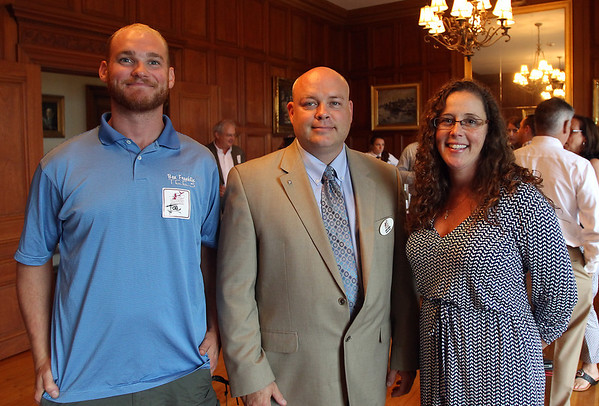 From left, Joe Schulte, of Ben Franklin Tees, John Somes, of the Greater Beverly Chamber of Commerce, and Eileen Geyer, of the Misselwood Estate, at a Multi-Chamber Networking event held at the Misselwood Estate at Endicott College on Wednesday evening. DAVID LE/Staff photo. 7/16/14.