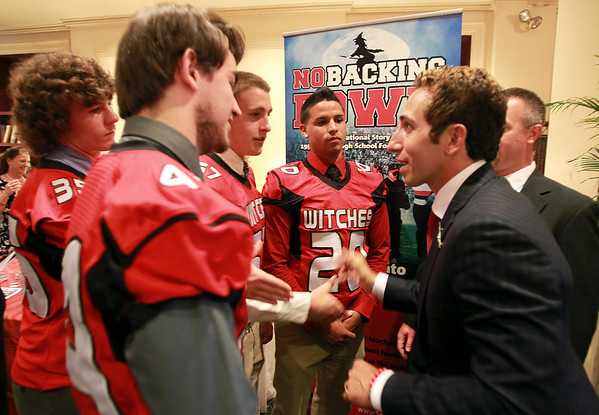 "NFL Player Agent Sean Stellato, right, talks with the four Salem High School football captains, Glen Gard, Victor Claudio, Joey Byors, and Genrri Rosario, at a gala and book signing for Stellato's new book ""No Backing Down"" a book on the 1994 Salem High School Super Bowl football team. DAVID LE/Staff photo. 7/11/14."