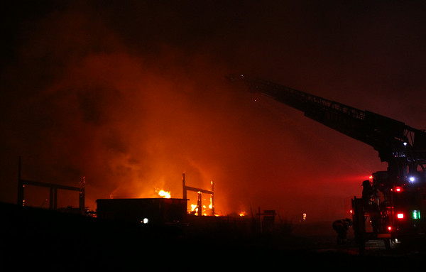 A large fire broke out at 29 Folger Ave in Beverly on Sunday evening, spraying sparks and smoke high in the sky. DAVID LE/Staff photo. 7/13/14.