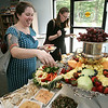 KEN YUSZKUS/Staff photo. Alice Phinizy and Dana Mead, both from the Women's Institute, sample some food during the post construction festivities at Turtle Creek in Beverly.  7/9/14