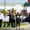 "A small group of protesters stand on the corner outside the Market Basket on Endicott Street in Danvers, waving to passing cars while holding signs asking passersby to honk in support of Arthur T. Demoulas, or ""Artie T,"" former CEO of Market Basket, who was fired earlier this month, sparking an uproar from many employees and Market Basket Supporters. DAVID LE/Staff photo. 7/23/14."