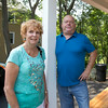 Middleton builder Michael Panzero saved a historical house located at 52 Centre Street in Danvers from being demolished and completely renovated the house. He stands on the porch with Sue _________. DAVID LE/Staff photo. 7/25/14.