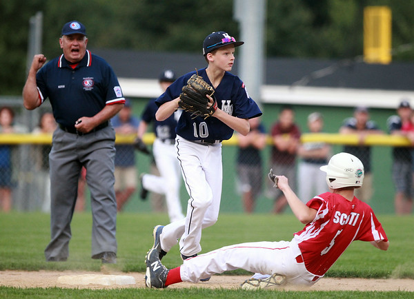 Hamilton-Wenham shortstop Cooper McGrath (10) makes the putout at second on sliding Barnstable runner Wyatt Scotti (5) and looks to complete the double play. The Generals lost to Barnstable 12-1 in a shortened 4 inning contest on Friday evening at Harry Ball Field in Beverly. DAVID LE/Staff photo. 7/25/14.