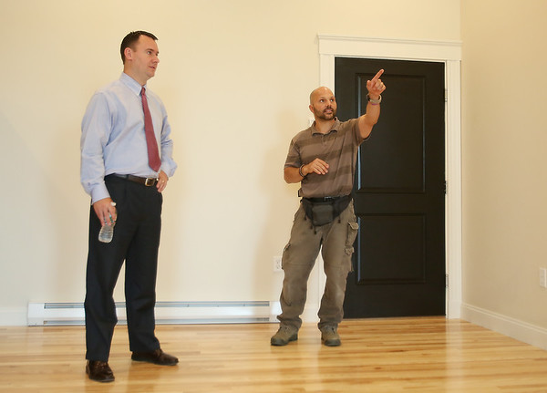Norman Lee, of Northeast Contractor Solutions Inc., right, points out a few features of one of the new apartment units located at 17 Main Street to Peabody Mayor Ted Bettencourt. The ten units are made up of eight 1-bedroom apartments and two studio apartments, and replaced the old Masonic Lodge which was vacant for over twenty years. DAVID LE/Staff photo. 7/31/14.