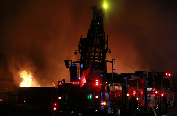 A 3-alarm fire broke out late on Sunday evening at 29 Folger Ave in Beverly. DAVID LE/Staff photo. 7/13/14.