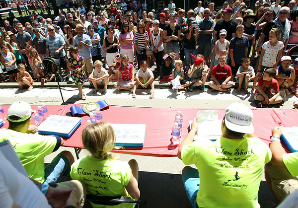 Hundreds of people gathered around the bandstand to watch the Lobster Roll Eating Contest during the first Salem Willows Seafood Festival on Saturday afternoon. DAVID LE/Staff photo. 7/12/14.