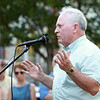 Former Beverly Mayor Bill Scanlon thanks a few hundred people who attended a short ceremony to dedicate a clock on Beverly Common to Scanlon for his 16 years in office. DAVID LE/Staff photo. 7/9/14.