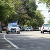 Salem Patrolman Victor Ruiz maneuvers his cruiser slowly down Congress Street in the Point Neighborhood on Tuesday afternoon. The Salem Police Department has been beefing up its presence in the neighborhood, especially at nighttime when outdoor parties and gatherings could occur. DAVID LE/Staff photo. 7/29/14.