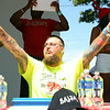 Mike Sullivan, of Salem, pumps up the crowd prior to the start of the Lobster Roll Eating Contest during the first Salem Willows Seafood Festival on Saturday afternoon. DAVID LE/Staff photo. 7/12/14.
