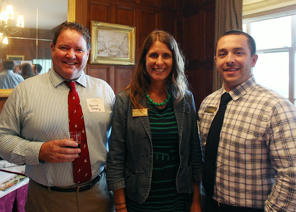 From left, Patrick Sheehy, of the Cricket Press, and Kristy Walker and Dave Giarrusso, of Endicott College, at a Multi-Chamber Networking event held at the Misselwood Estate at Endicott College on Wednesday evening. DAVID LE/Staff photo. 7/16/14.