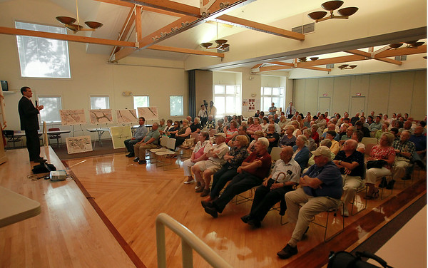 A packed house at the Beverly Senior Center listen to Mayor Mike Cahill, left, at the start of a meeting to discuss the current design for the new connector road between Sohier and Brimbal Avenues on Thursday evening. DAVID LE/Staff photo. 7/24/14.