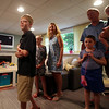 The Fessenden family looks on as Melinda Cabanilla, Director of Special Spaces reveals a secret doorway in the new playroom. With the help of 75 volunteers, a nonprofit called Special Spaces Boston, did a three-day makeover of the downstairs playroom for Riley Fessenden and her brothers and sisters. DAVID LE/Staff photo. 7/26/14.