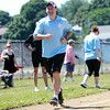 Peabody Mayor Ted Bettencourt smiles as he rounds third base after launching a home run in a charity softball game between Salem and Peabody City officials on Saturday morning. DAVID LE/Staff photo. 7/12/14.