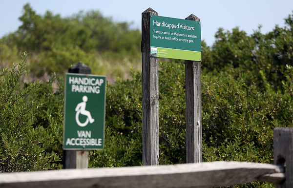 A helpful sign intended for handicapped visitors to Cranes Beach sits along the parking area. DAVID LE/Staff photo. 7/31/14.
