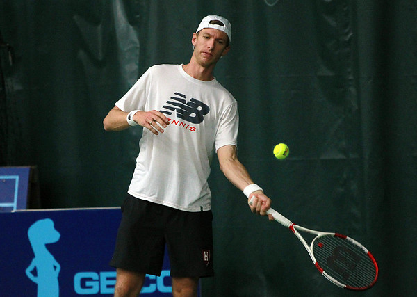 Boston Lobsters tennis star Eric Butorac warms up prior to a match against the San Diego Aviators at the Manchester Athletic Club on Wednesday evening. DAVID LE/Staff photo. 7/16/14.
