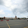 The Highland Ave Market Basket parking lot was virtually empty on Thursday afternoon as shoppers have taken their business elsewhere as the Market Basket controversy continues. DAVID LE/Staff photo. 7/31/14.