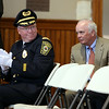 Interim Chief of Police Bob St. Pierre, right, gets applauded by newly appointed Chief of Police Tom Griffin, left, after Peabody Mayor Ted Bettencourt thanked St. Pierre for stepping in. DAVID LE/Staff photo. 7/24/14.