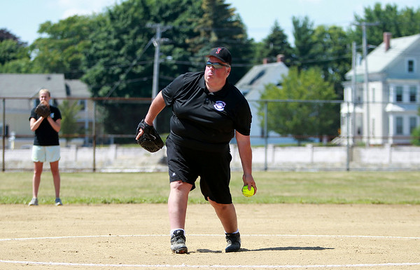 Salem Ward 1 City Councillor Bob McCarthy throws a pitch during a charity softball game between Salem and Peabody City officials on Saturday morning. DAVID LE/Staff photo. 7/12/14.