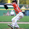 Beverly starting pitcher Shane Cassidy fires a pitch against Danvers American on Tuesday evening at Harry Ball Field in Beverly. DAVID LE/Staff photo. 7/8/14.