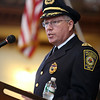 Newly sworn-in Peabody Police Chief Tom Griffin makes a short speech to a large crowd in the Wiggin Auditorium at Peabody City Hall on Thursday afternoon. DAVID LE/Staff photo. 7/24/14.